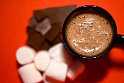 Hot chocolate, marshmallows and chocolate pieces.