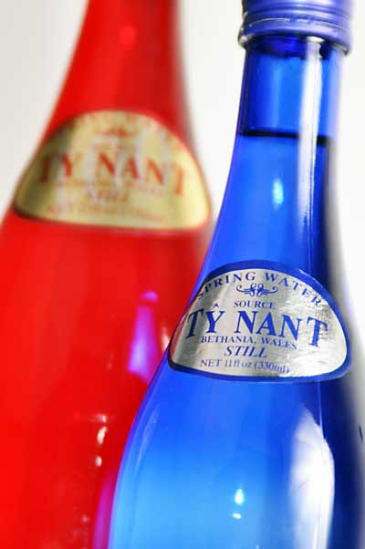 Red and blue bottles of water.