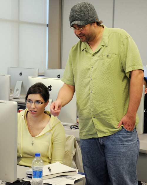 Ashley Maw, a GDC sophomore student, gets help from Lance Geving.