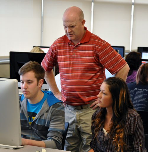 Ryan Pitcher helps design and spanish students with translation.
