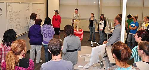 Bismarck State College Freshman Kennon Kirwan describes the idea that his group put together during a Friday activity.